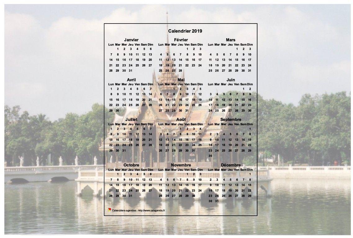 Calendrier 2019 annuel à imprimer, format paysage, une ligne par trimestre, incrusté au centre d'une photo